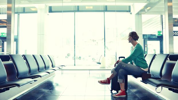 shutterstock_178236536_woman_airport_620px