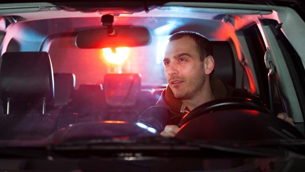 shutterstock_172022516_man_driving_cops_620px