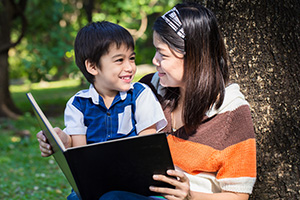 shutterstock_241607581_mom_reading_300px