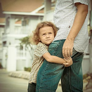 shutterstock_196714871_son_holding_onto_father_300px