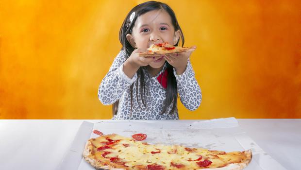 shutterstock_149608760_girl_eating_pizza_620px